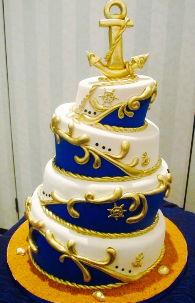 Carrying A Theme Of Navy Blue And Gold With White Is Always Classic Elegant Presentation For Wedding Cakes But You Could Also Add Seashells Or